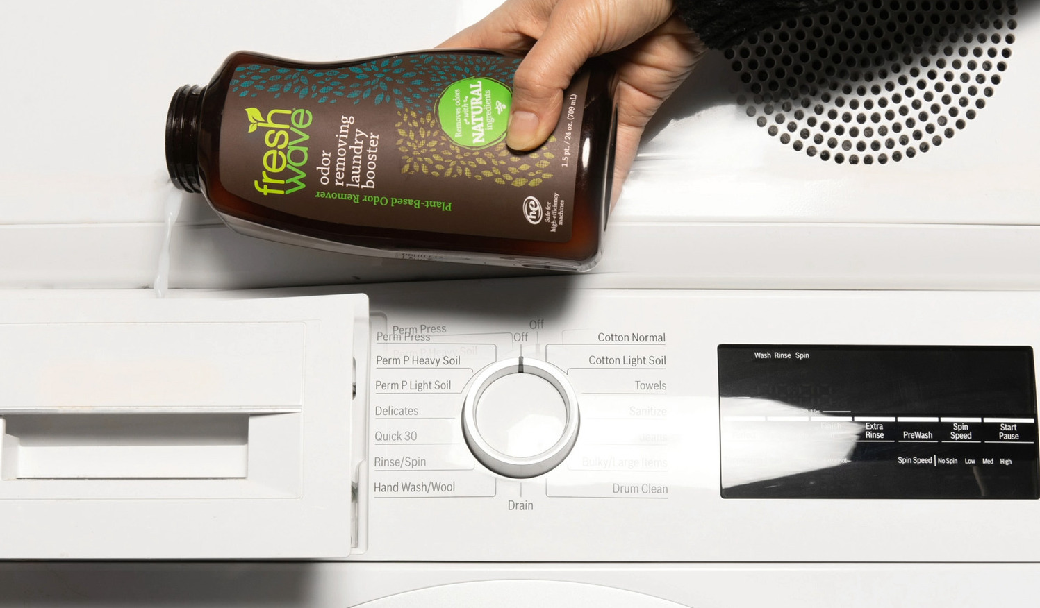 Laundry Booster Pouring into Washing Machine